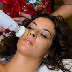 Woman getting acne facial at day spa in Phoenix, AZ
