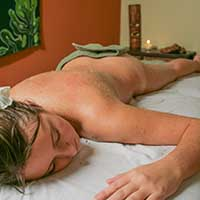 Woman receiving body scrub at Goodyear, AZ day spa
