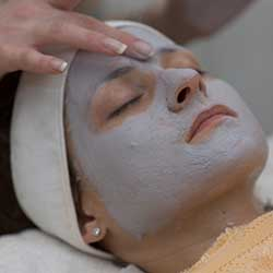 Woman getting facial in day spa in Phoenix, AZ area.