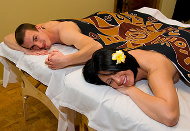 Couple holding hands during romantic massage in Arizona day spa