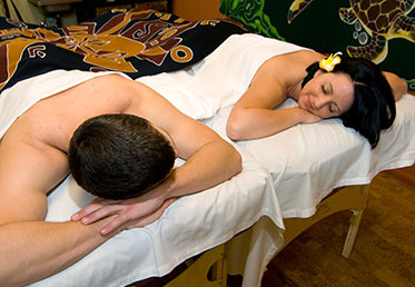 Couples facing eachother during romantic massage