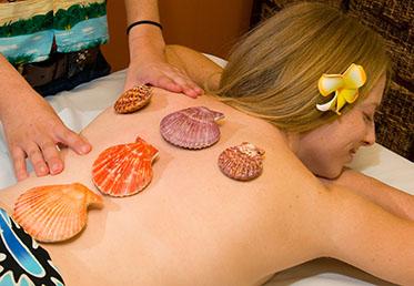 Person getting hot sea shell massage in Phoenix spa