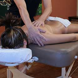 Woman receiving lomi lomi massage in Chandler, AZ day spa