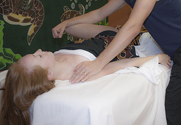 Woman getting hip stretched during sports massage in Goodyear