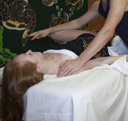 Client receiving sports massage in Phoenix, AZ area day spa