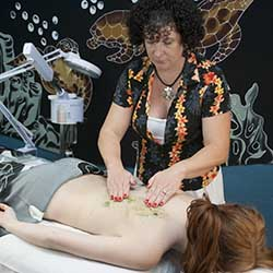 Woman getting back facial at Chandler, AZ day spa