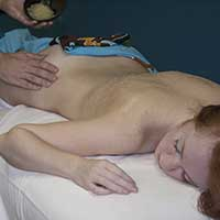 Woman getting body scrub in Chandler, AZ day spa
