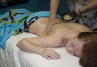 Woman receiving spa body scrub in Chandler, AZ