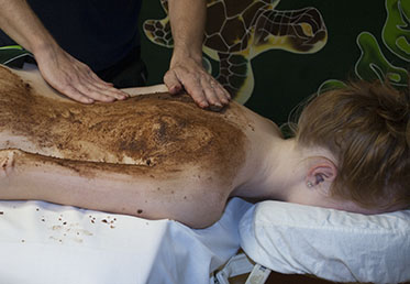 Woman receiving chocolate body scrub at day spa in Scottsdale, AZ