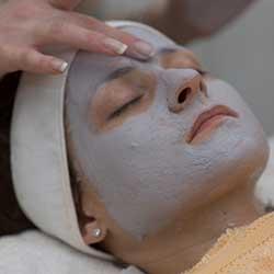 Woman getting facial in day spa in Phoenix, AZ area.