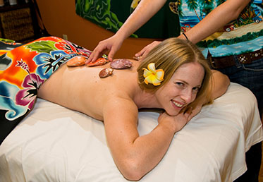 Woman getting massaged with sea shells in day spa
