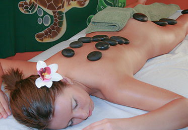Person covered in hot stones at day spa in Scottsdale, AZ