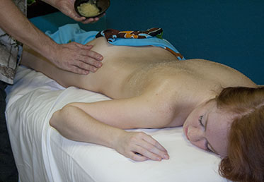 Woman receiving lavender spa treatment in Chandler, AZ