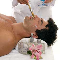 Man getting facial at day spa