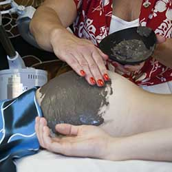 Woman getting buttocks facial in Phoenix, AZ spa