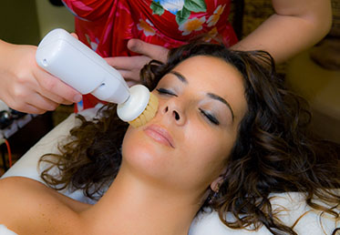 Woman receiving spa facial in Phoenix day spa