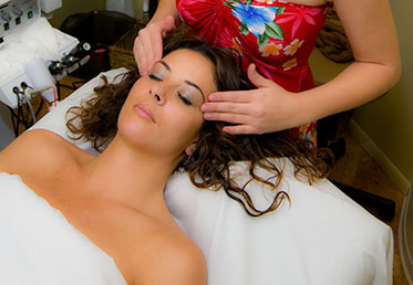 Woman getting day spa facial in Goodyear, AZ